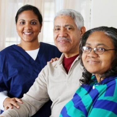 13398928 - home health care worker and an elderly couple